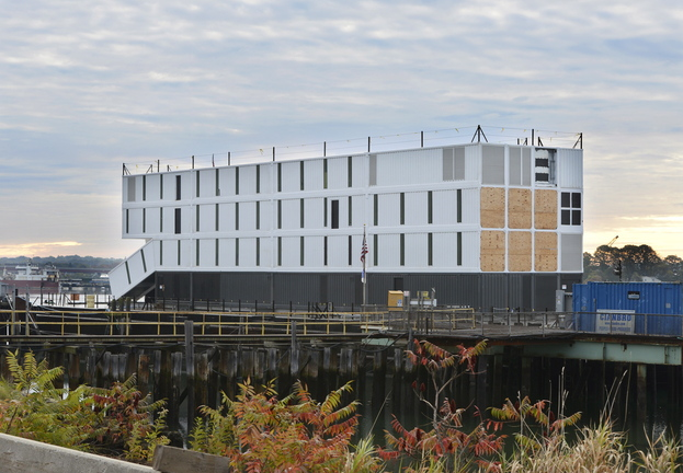 A barge holding a mysterious four-story structure has been tied up at Cianbro Corp.'s Rickers Wharf Marine Facility off Commercial Street in Portland since its arrival on Oct. 11.