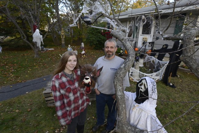 John Robertson and his daughter Isabel, 15, have created a haunting scene in front of their Cape Elizabeth home.