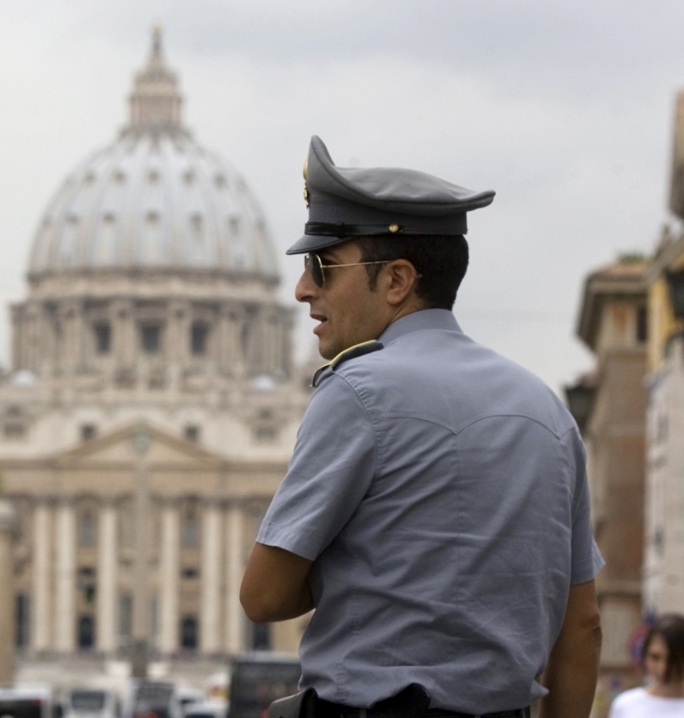 A financial officer stands in front of St. Peter's Square at the Vatican, which revealed facts about its bank Tuesday.