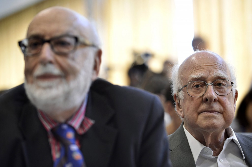 In this July 2012 photo, Belgium physicist Francois Englert, left, and British physicist Peter Higgs answer journalists' questions at the European Organization for Nuclear Research (CERN) in Meyrin near Geneva, Switzerland.