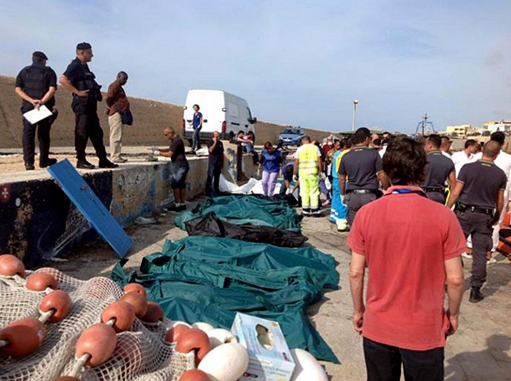 Bodies of drowned migrants are lined up in the port of Lampedusa Thursday, Oct. 3, 2013. A ship carrying African migrants to Europe caught fire and capsized off the Italian island of Lampedusa on Thursday, killing at least 94 people as it spilled hundreds of passengers into the sea, officials said. Over 150 people were rescued but some 200 others were still unaccounted for. It was one of the deadliest recent accidents in the notoriously perilous Mediterranean Sea crossing from Africa for migrants seeking a new life in the European Union.