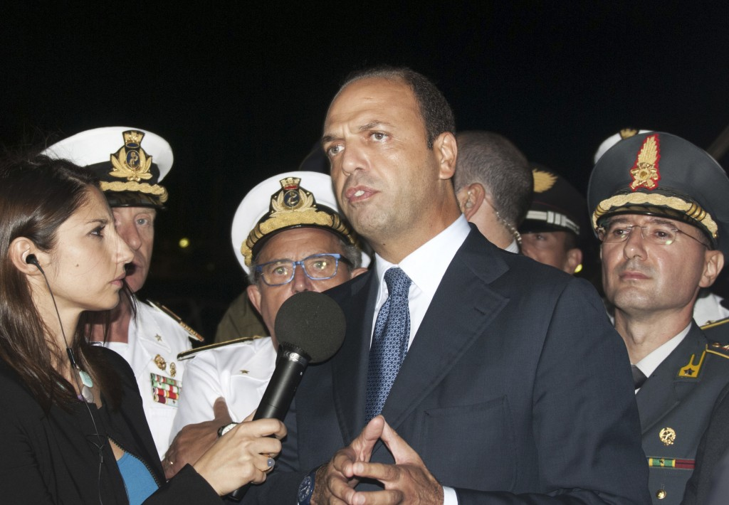 Interior Minister and Deputy Premier Angelino Alfano gives a statement to the press upon his arrival in the Sicilian island of Lampedusa, southern Italy, Thursday, Oct. 3, 2013. At least 114 people died and scores more were missing late Thursday after a crowded fishing boat carrying African migrants from Tripoli caught fire, flipped over and sank, Italian officials said. Hundreds of migrants reach Italy's shores every day, particularly during the summer when the seas are usually calmer. According to the U.N. refugee agency, 8,400 migrants landed in Italy and Malta in the first six months of this year, almost double the 4,500 who arrived during the first half of 2012.