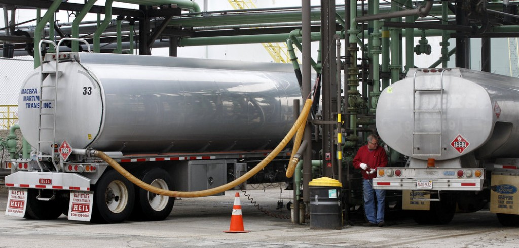 An oilman prepares to fill his truck with home heating fuel at a depot in Quincy, Mass., in 2011. Most Americans will pay more to heat their homes this winter, according to government forecasts out this week.