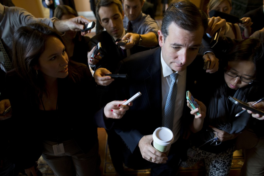 Sen. Ted Cruz, R-Texas, is followed by reporters as he walks to a Senate GOP meeting on Capitol Hill on Wednesday, Oct. 16, 2013 in Washington.