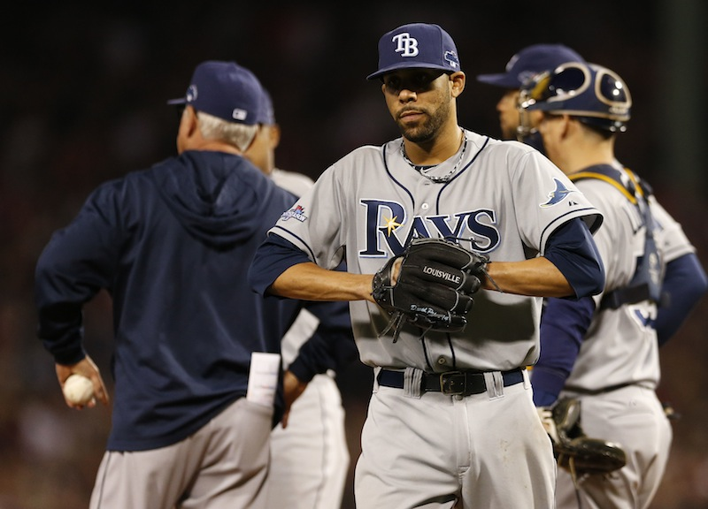 Tampa Bay Rays manager Joe Maddon, left, holds the ball as starting pitcher David Price leaves the baseball game in the top of the eighth inning in Game 2 of the Rays' American League division series against the Boston Red Sox Saturday, Oct. 5, 2013, in Boston. (AP Photo/Michael Dwyer) MLB