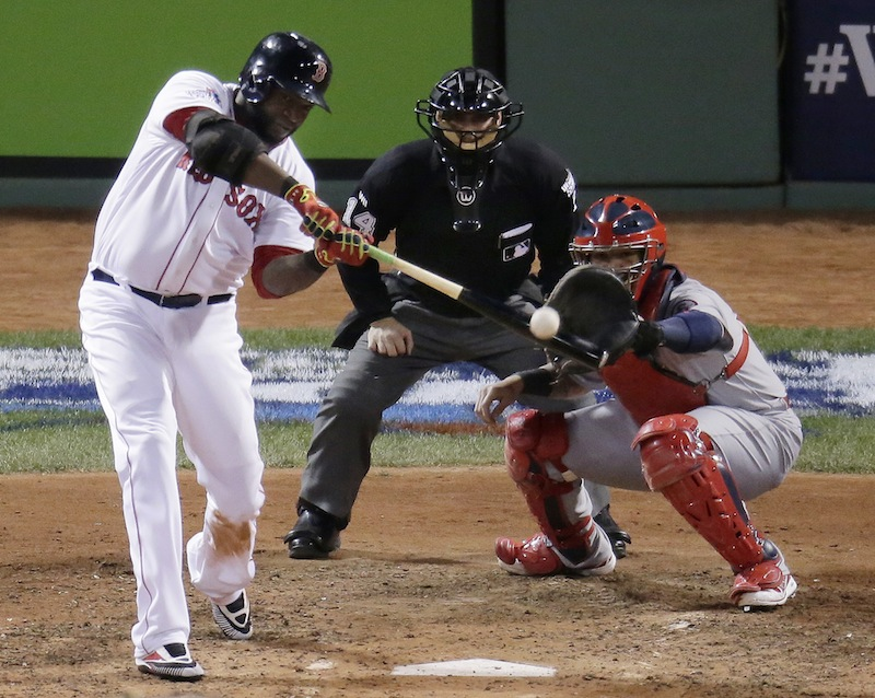 Boston Red Sox's David Ortiz hits a two-run home run during the sixth inning of Game 2 of baseball's World Series against the St. Louis Cardinals Thursday, Oct. 24, 2013, in Boston. MLB