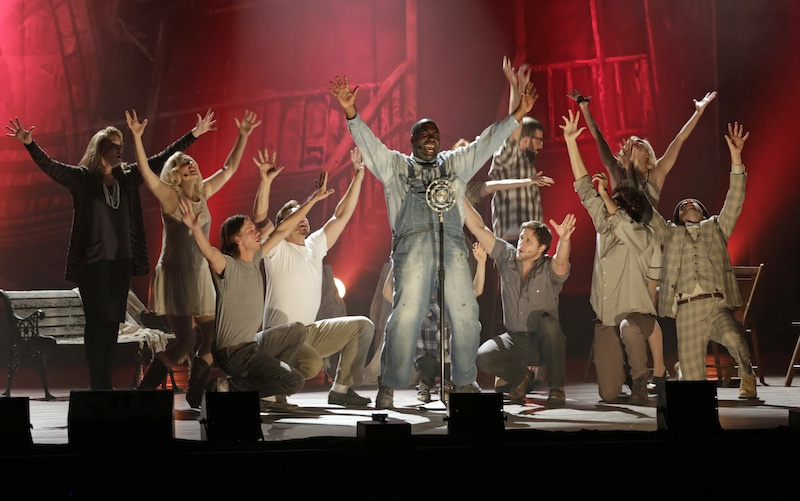 Eric Moore, as Dan Coker, center, performs during a dress rehearsal of the musical