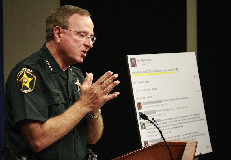 Polk County Sheriff Grady Judd talks about the events leading up to the arrest over the weekend of two juvenile girls in a Florida bullying case at a press conference in Winter Haven, Fla., Monday, Oct. 15, 2013. Two middle school girls ages 14 and 12 have been arrested and charged with felony aggravated stalking in connection with the suicide earlier this year of 12-year-old Rebecca Ann Sedwick in Lakeland. Judd said police arrested the 14-year-old girl after she posted online Saturday that she bullied Rebecca and she didn't care. The 12-year-old girl was Rebecca's former best friend, but Judd said the 14-year-old girl turned her against Rebecca.