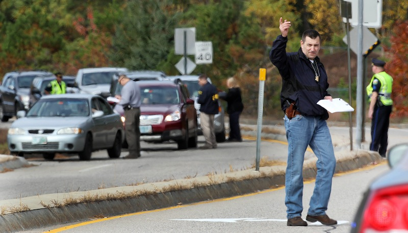 With the help of state and local police, FBI agents set up a road block to question drivers Wednesday, Oct. 16, 2013, in North Conway, N.H., The road is where 15-year-old Abigail Hernandez would have walked home from school. Its been a week since the teenager was last seen leaving school.