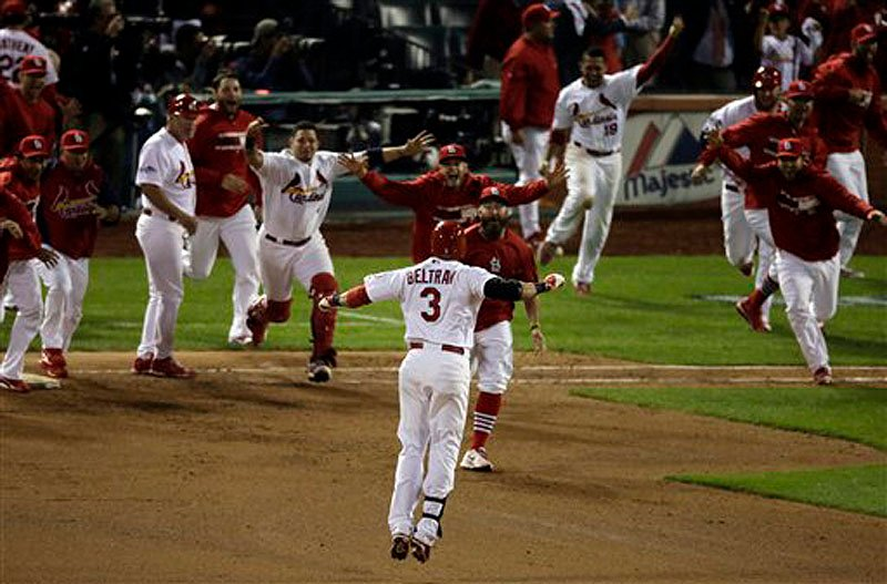 St. Louis Cardinals' Carlos Beltran celebrates with teammates after his game-winning hit in the 13th inning of Game 1 of the National League Campionship Series against the Los Angeles Dodgers on Saturday in St. Louis.