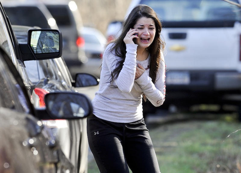 In this Dec. 14, 2012 file photo, Carlee Soto reacts as she learns her sister, Victoria Soto, a teacher at the Sandy Hook Elementary School, was one of 26 people killed in a shooting at the school in Newtown, Conn.