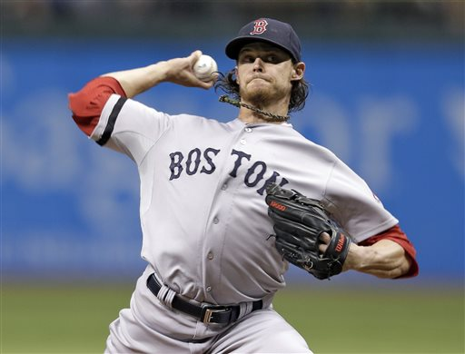 Boston Red Sox starting pitcher Clay Buchholz delivers to Tampa Bay Rays' David DeJesus during the first inning of a baseball game Tuesday, Sept. 10, 2013, in St. Petersburg, Fla. (AP Photo/Chris O'Meara) Tropicana Field
