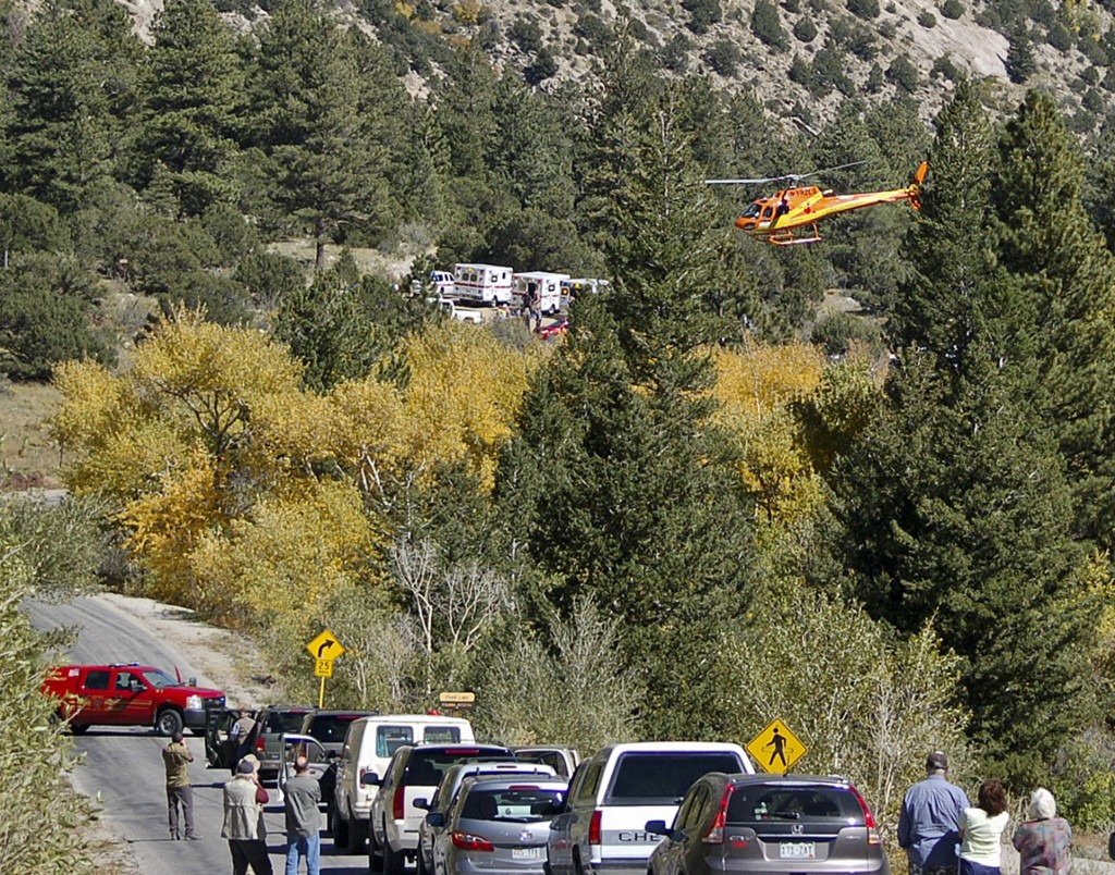 A Flight for Life Helicopter rises above backed up traffic Monday in south-central Colorado. Roads were closed as emergency personnel work to aid hikers trapped after a rock slide on the trail to Agnes Vaille Falls.