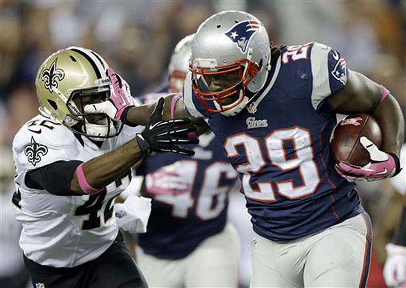 New England Patriots running back LeGarrette Blount (29) stiff-arms New Orleans Saints free safety Isa Abdul-Quddus (42) as he runs for yardage in the third quarter Sunday in Foxborough, Mass. NFLACTION13;