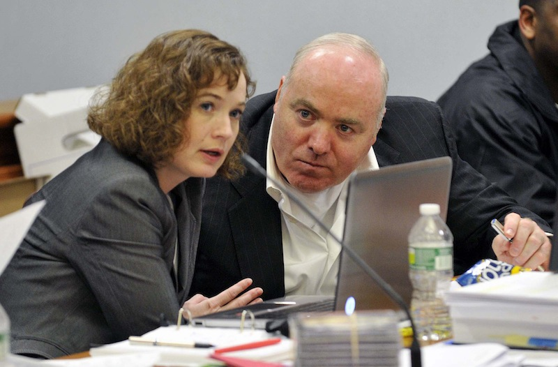 Michael Skakel, right, talks to Jessica Santos, one of his defense attorneys, in April during his appeal at state Superior Court in Vernon, Conn.