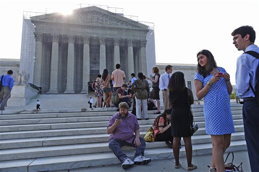 In this June 2013 file photo, people line up in front of the Supreme Court in Washington before it opened for its last scheduled session. In the court's first major campaign finance case since the Citizens United ruling in 2010, the national Republican party wants the court to overturn the $123,200 limit on what contributors may give in a two-year federal election cycle.