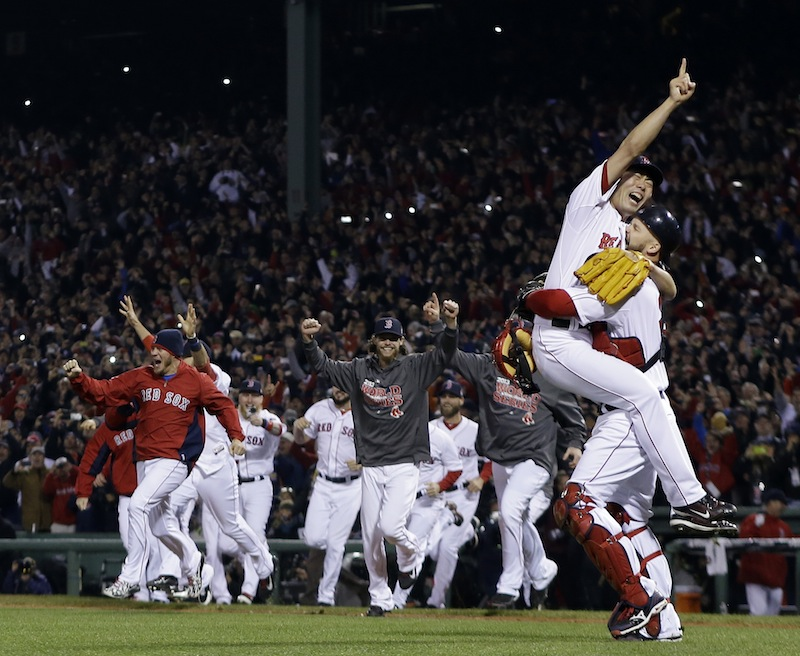 Boston Red Sox relief pitcher Koji Uehara and catcher David Ross celebrate after getting St. Louis Cardinals' Matt Carpenter to strike out and end Game 6 of baseball's World Series Wednesday, Oct. 30, 2013, in Boston. The Red Sox won 6-1 to win the series. MLB