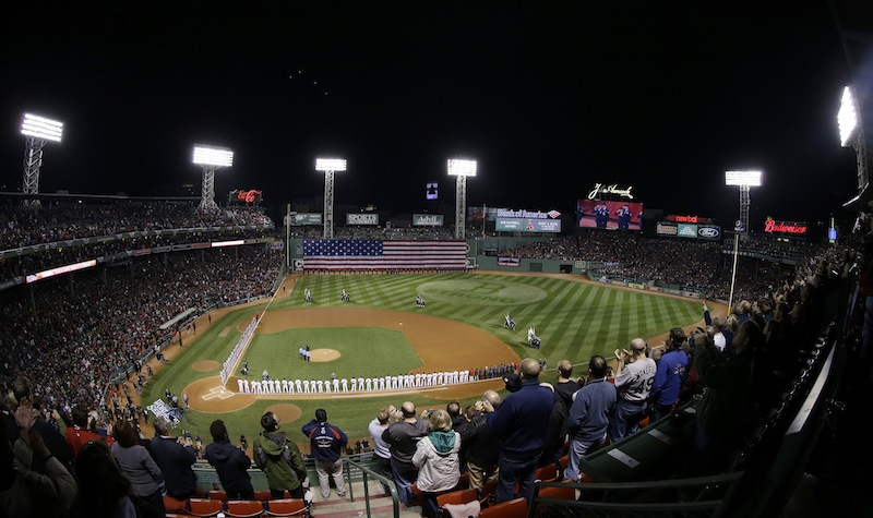 Players line up for the national anthem before Game 1 of baseball's World Series between the Boston Red Sox and the St. Louis Cardinals Wednesday, Oct. 23, 2013, in Boston. MLB