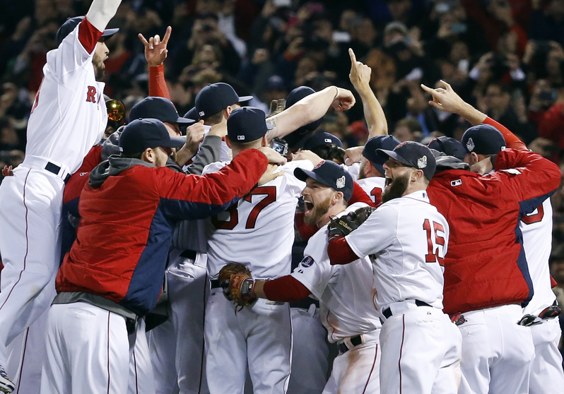 Boston Red Sox players celebrate on the field after they defeated the St. Louis Cardinals 6-1 in Game 6 of baseball's World Series on Wednesday at Fenway Park in Boston.