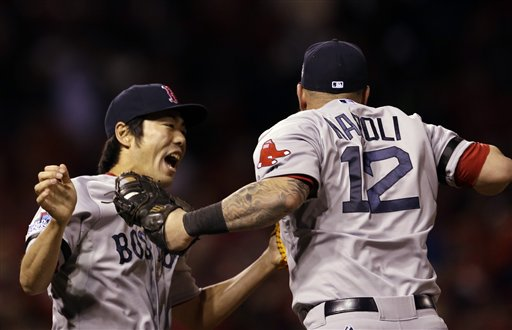 Boston Red Sox's Koji Uehara and Mike Napoli (12) celebrate after Game 4 of baseball's World Series against the St. Louis Cardinals Sunday, Oct. 27, 2013, in St. Louis. The Red Sox won 4-2 to ties the series at 2-2. (AP Photo/Jeff Roberson) MLB