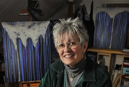 """Artist Pamala Crabb of Springvale will show her multimedia abstracts in an exhibition called """"Alzheimer Forgets,"""" inspired by her personal feelings about her father's illness. Crabb is shown in the studio she created in her home."""
