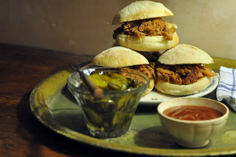 Pulled-pork sliders with sweet jalapeno-spiked pickles should keep football watchers pleasantly filled for even extra-long games.