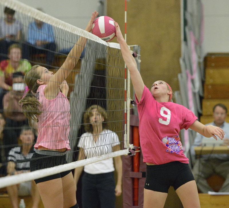 Kayley Cimino of Greely, right, hits the ball over the net against Abby Mills of Scarborough during their high school volleyball match Tuesday night. Scarborough beat the Rangers for the second time this season.