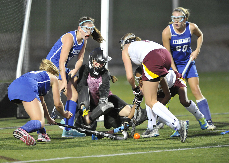 Cape Elizabeth goalkeeper Mary DiPietro keeps her eye on the ball while teammate Hailey Petsinger tries to clear it from a slew of Kennebunk players who never did find the back of the net in Tuesday's game.