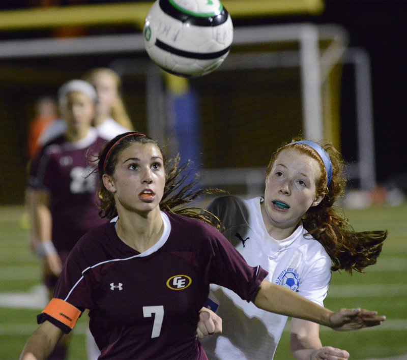 Kathryn Clark of Cape Elizabeth attempts to hold off Emma England of Falmouth and keep the inside track for the ball Wednesday night in the Capers' 2-1 victory in a game between two of the best teams in Western Maine schoolgirl soccer.