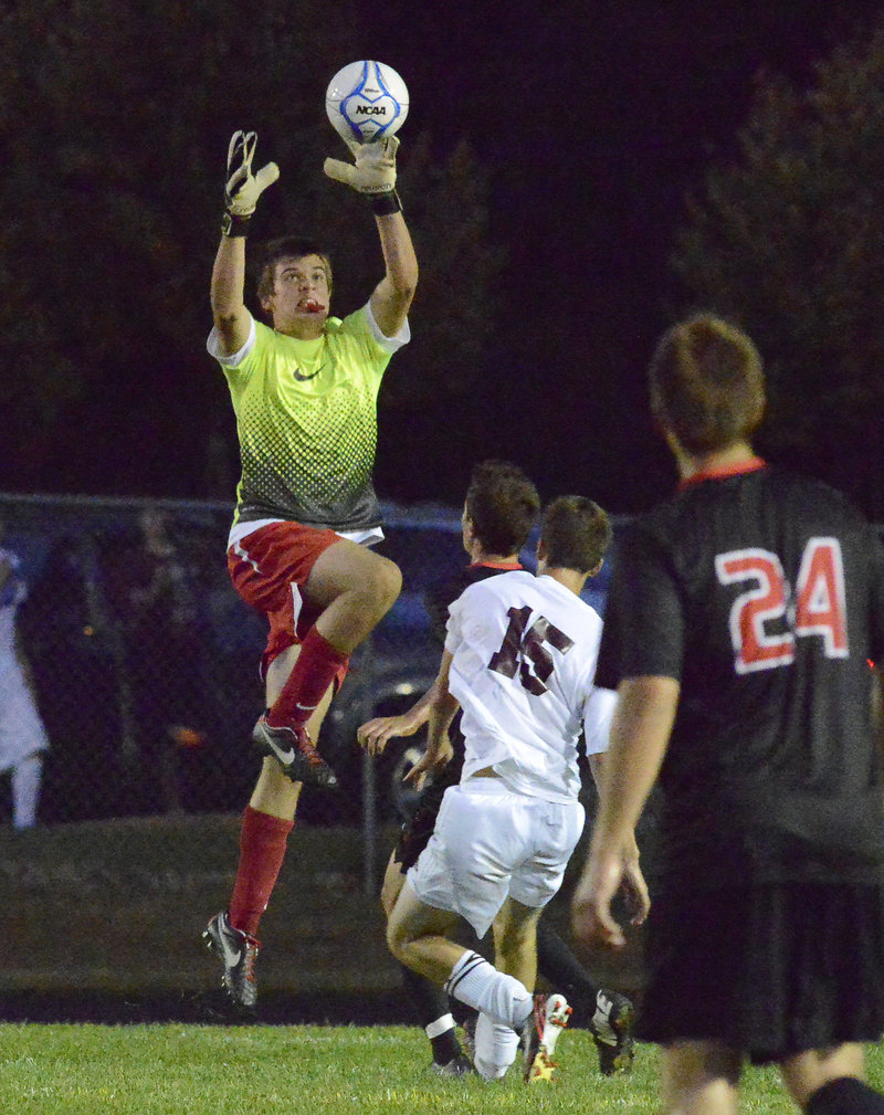 Scarborough goalkeeper Pat Stanton makes sure that Gorham doesn't get a chance to score with a defender helping in front.