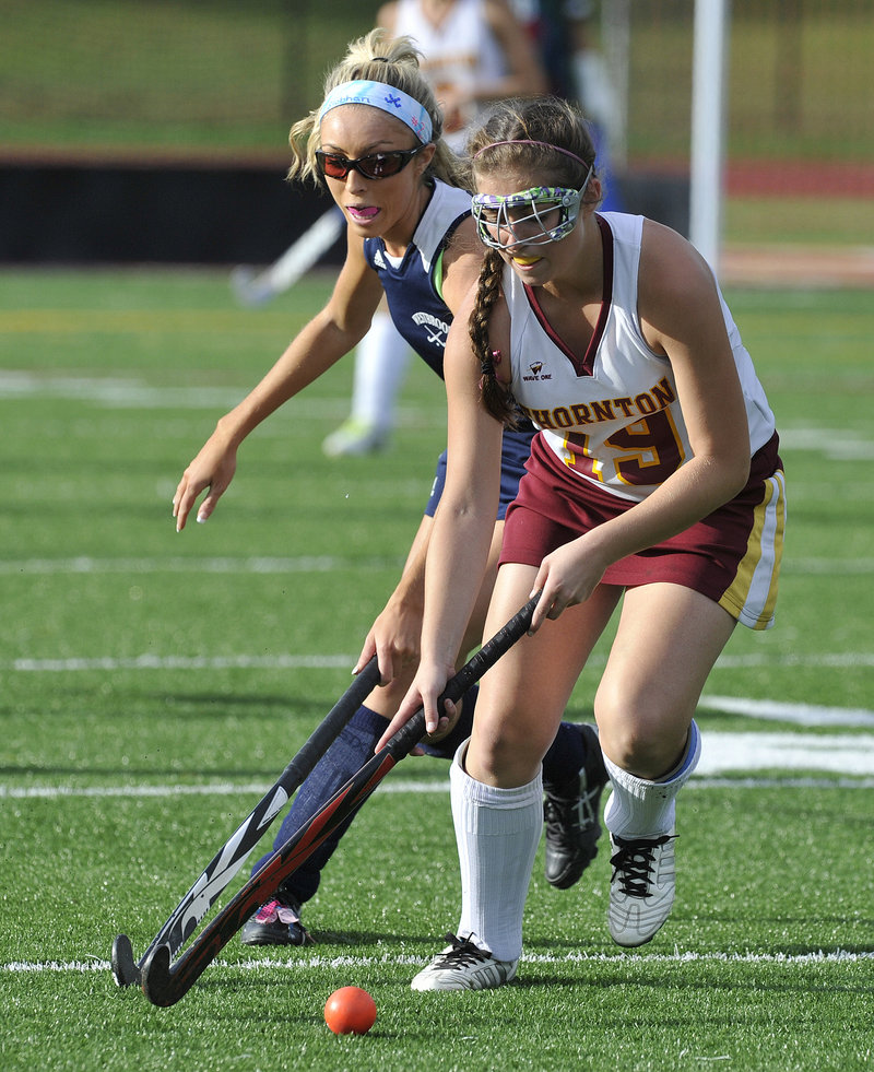 Francesca Petrucci of Thornton Academy moves the ball upfield while pursued by Siobhan Foley of Westbrook.