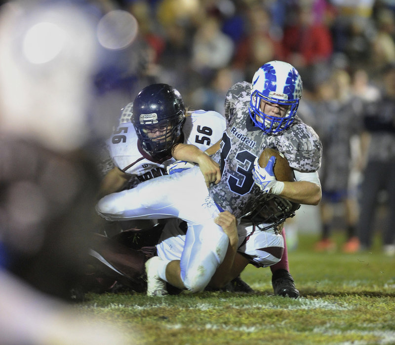 Nicco DeLorenzo of Kennebunk is pulled down after a big gain Friday night during the 42-14 victory against Greely. The Rams imporved to 5-0 in Western Class B and dropped the Rangers to 3-2.