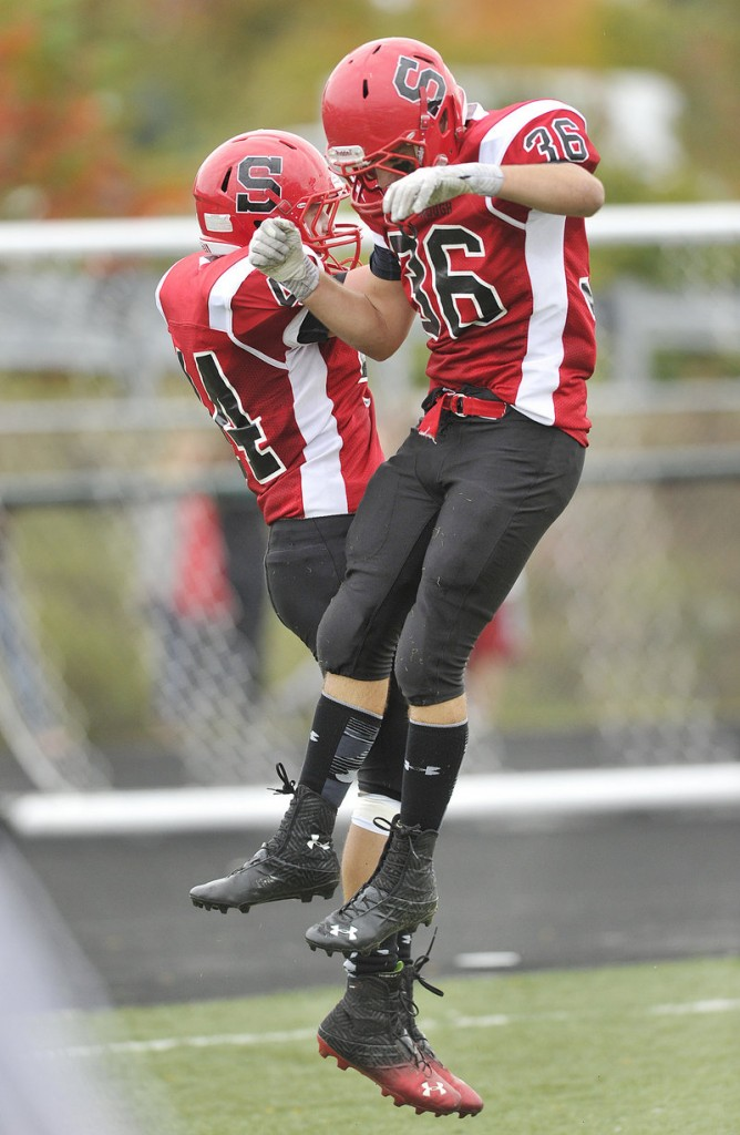 Brendan Smith, left, and Dan LeClair of Scarborough celebrate Smith's touchdown reception in the first half.