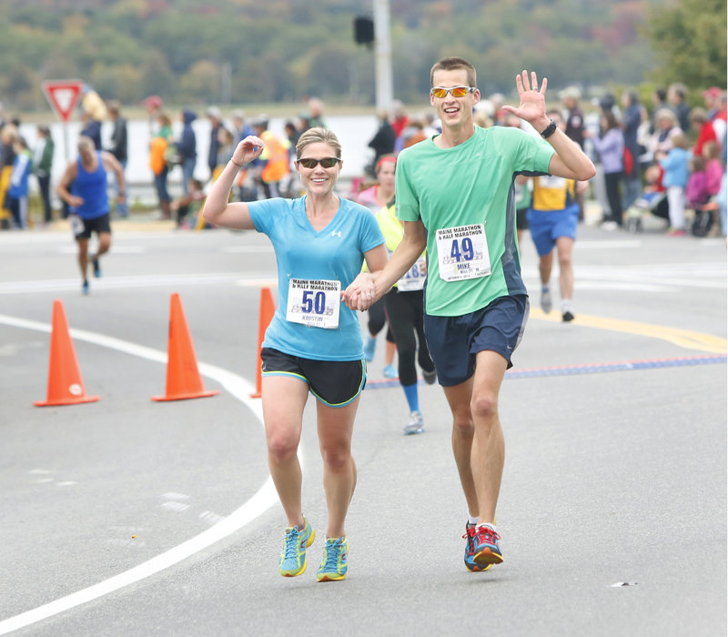 Kristin and Mike Kiss of Illinois complete, hand in hand, their 50th race in 50 states, in under two hours. Now the couple, who have been together since they were 16, will be looking for new physical challenges.