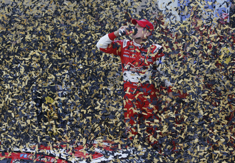 Kevin Harvick celebrated in black and gold Sunday after he pulled away from Kurt Busch and Jeff Gordon to win a wreck-filled race at Kansas Speedway, leaving him in third place in the Sprint standings and in position to advance on Matt Kenseth and Jimmie Johnson.
