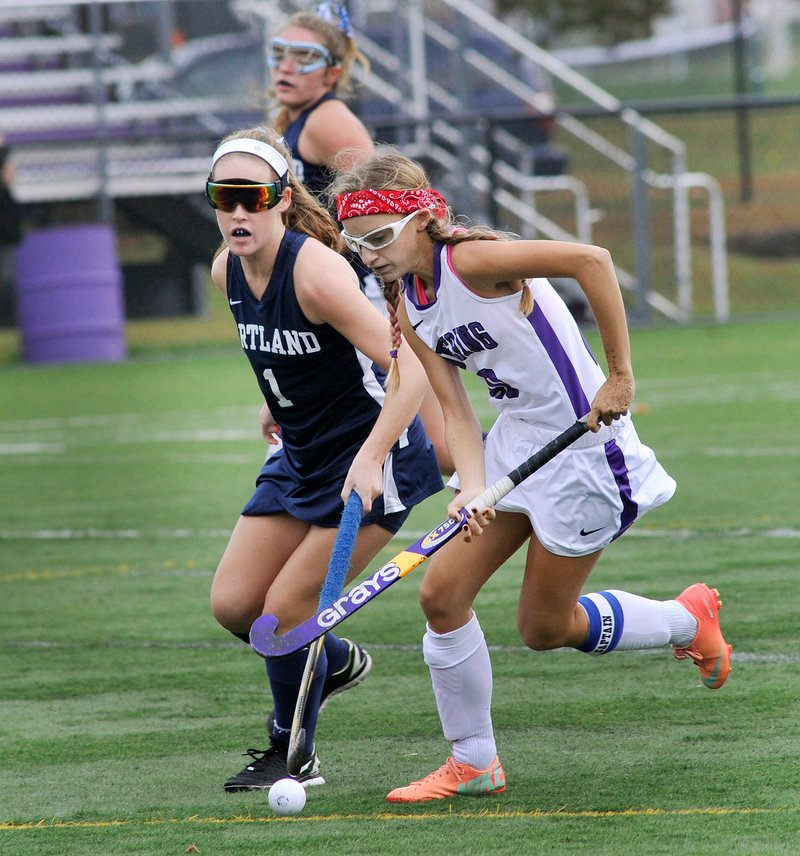Amanda LeMoult, right, of Deering outraces Portland's Georgia Drew for the ball near midfield in Monday's SMAA field hockey game. Deering won 4-0.