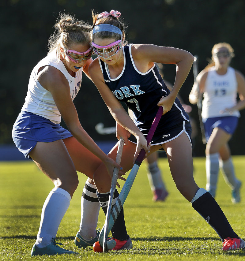 Taylor Simpson of York, right, was pursued by colleges in all three divisions before she decided on Merrimack, a national Division II field hockey power.