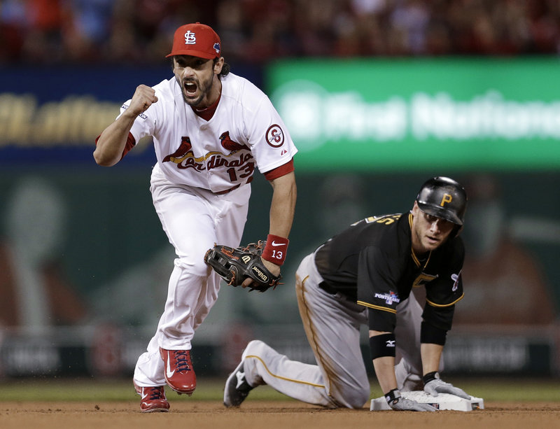 Second baseman Matt Carpenter of the St. Louis Cardinals celebrates Wednesday night after forcing Clint Barmes, then completing a double play. The Cards beat the Pirates, 6-1.