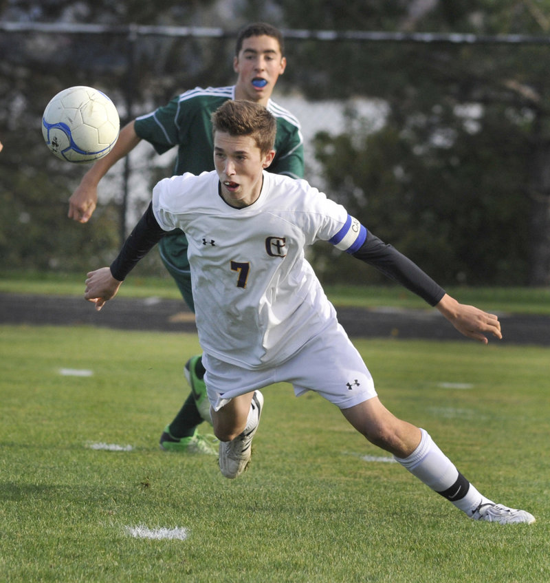 Charlie Mull of Cheverus heads a pass to a teammate in front of Baxter Nichols of Bonny Eagle during their SMAA game Thursday in Portland. Mull had a goal for the Stags during the 4-2 victory.