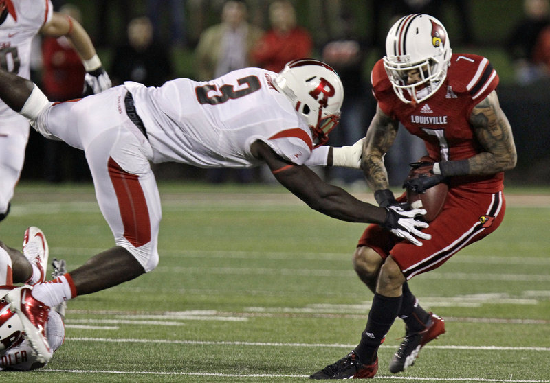 Louisville receiver Damian Copeland eventually got the handle on this pass as Rutgers' Steve Longa pressures the play during No. 8 Louisville's 24-10 win at home Thursday night.