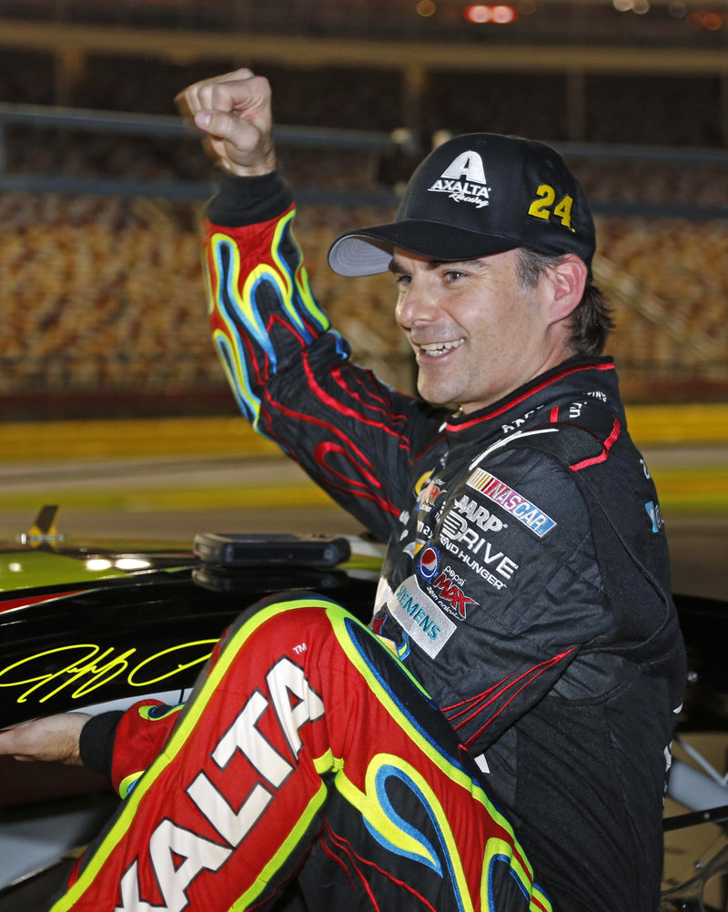 Jeff Gordon is clearly happy about his strong racing of late, as he exits his car Thursday in Charlotte, N.C., where he won the pole position for Saturday's NASCAR Sprint Cup race.