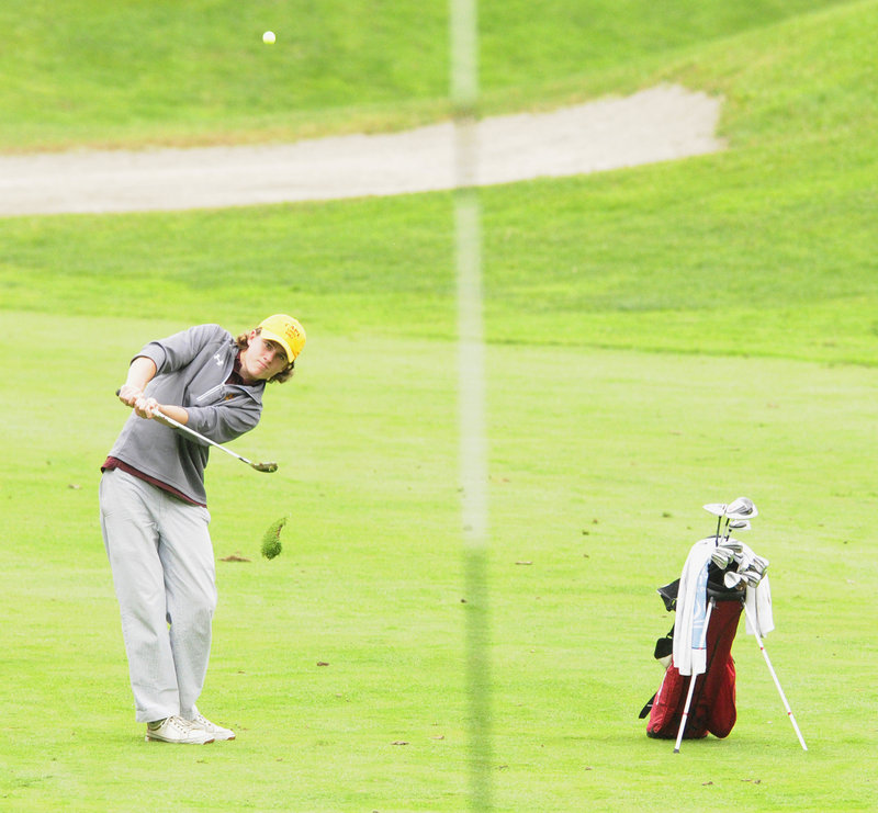 Reese McFarlane of Cape Elizabeth chips onto the eighth green Saturday during the state team championships at Natanis. McFarlane shot a 75. The Capers were second in Class B.