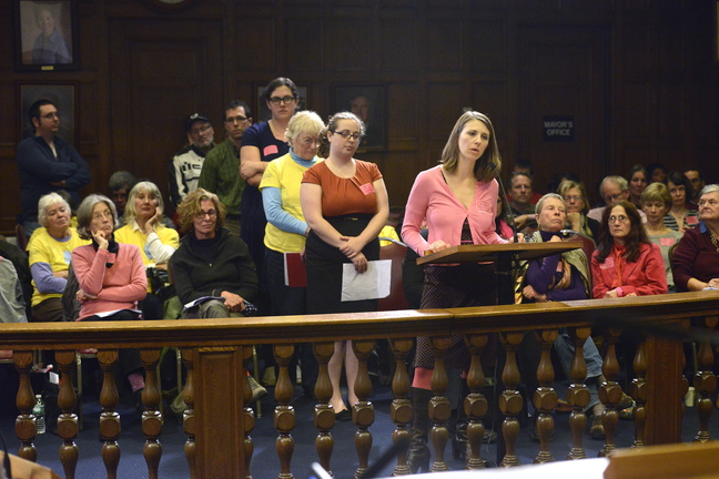 As Amanda Boger of Portland speaks, members of the public wait their turn to address the City Council during a hearing Monday evening on a proposed buffer zone around Planned Parenthood.