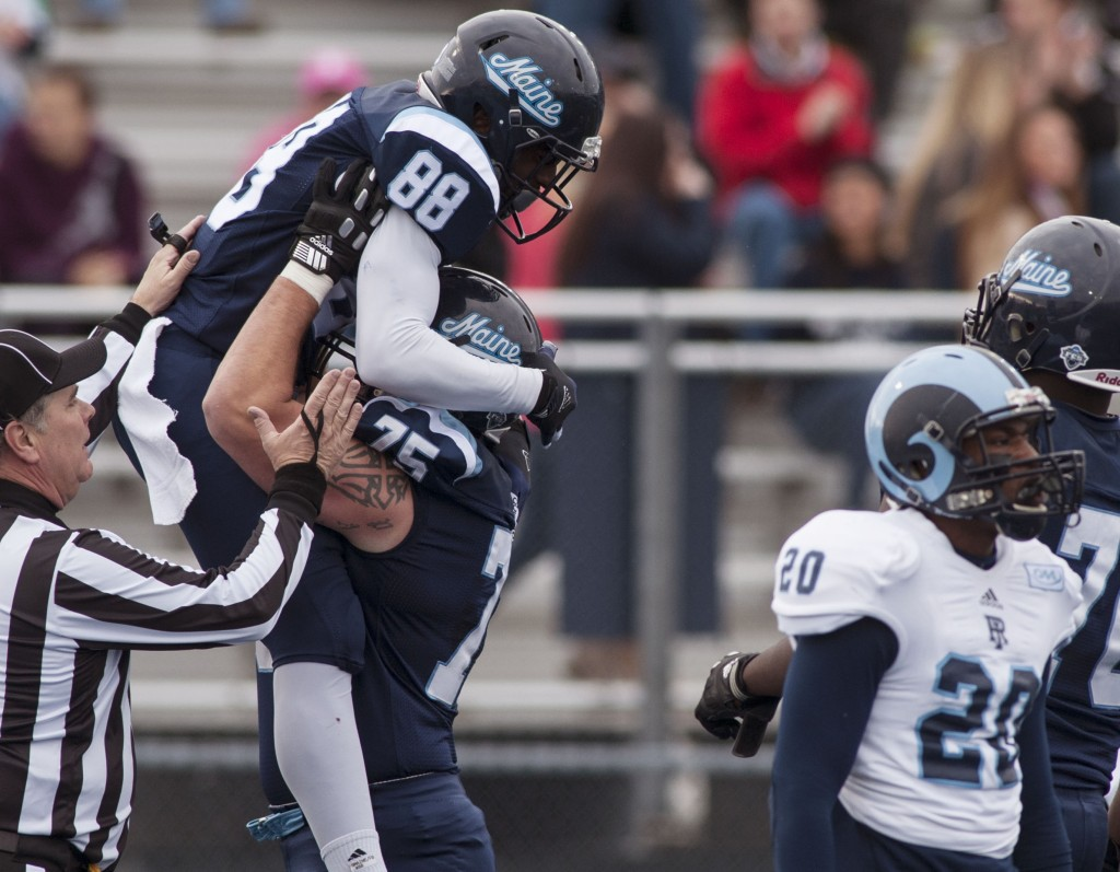 Maine wide receiver DamarrAultmann, 88, celebrates with teammate Joseph Hook after scoring against Rhode Island in the first half of Maine's 41-0 victory Saturday at Orono. The Black Bears