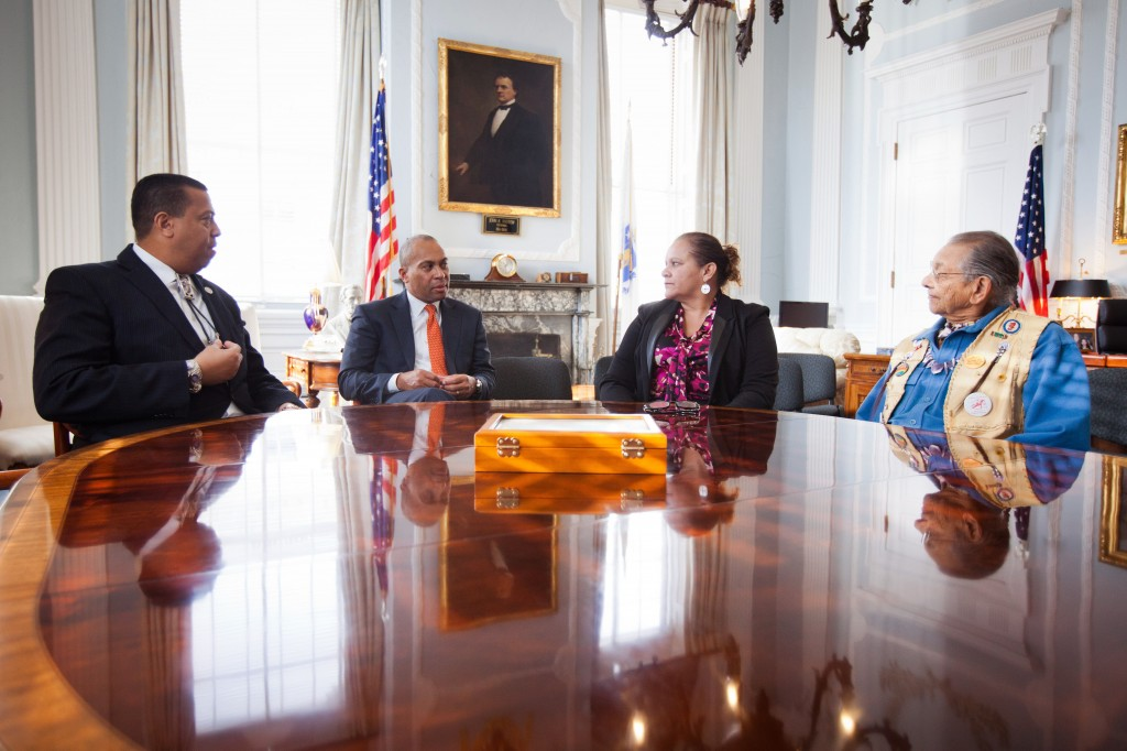 Mass. Gov. Deval Patrick sits with Mashpee Wampanoag Chairman Cedric Cromwell, far left, Vice Chairwoman Jesse Little Doe Baird and Chief Vernon Lopez, far right, on Friday at the Statehouse in Boston, where he signed a revised casino compact between the Mashpee Wampanoag tribe and the Commonwealth of Massachusetts. Tribal leaders, who hope to build a resort casino in Taunton, say they're confident the revised casino compact will be approved by the federal Bureau of Indian Affairs.