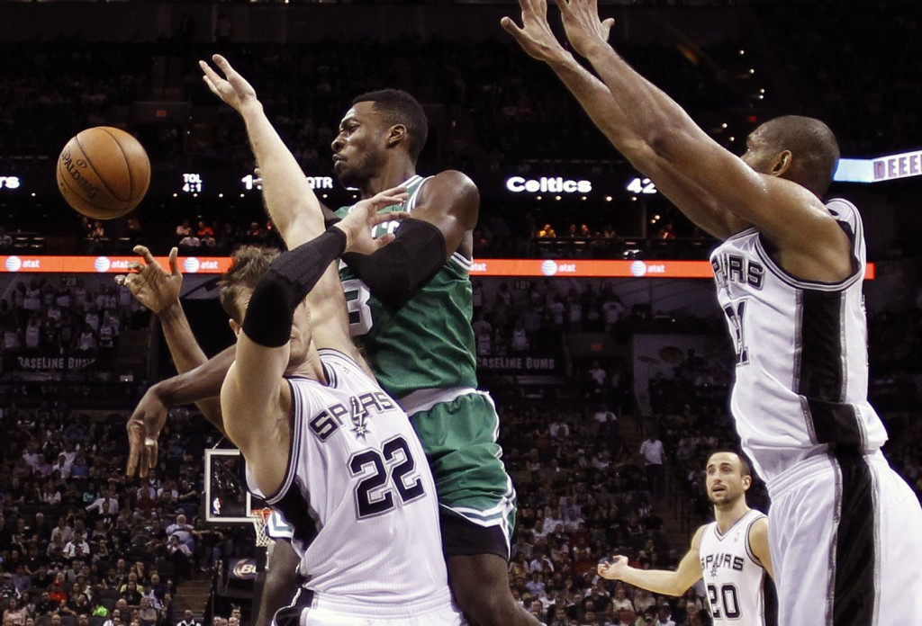 Boston's Jeff Green is defended by San Antonio's Tiago Splitter, 22, as he tries to score during Wednesday night's game in Texas, won by the Spurs.