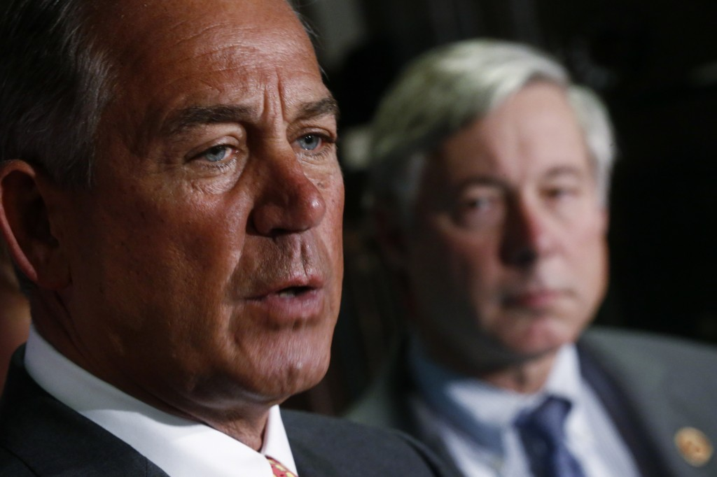 House Speaker John Boehner of Ohio, left, speaks about President Obama's health care law Wednesday. Looking on is Rep. Fred Upton, R-Mich., who has proposed a bill that would allow insurers to keep selling insurance that doesn't offer the type of benefits required by Obama's health care law.