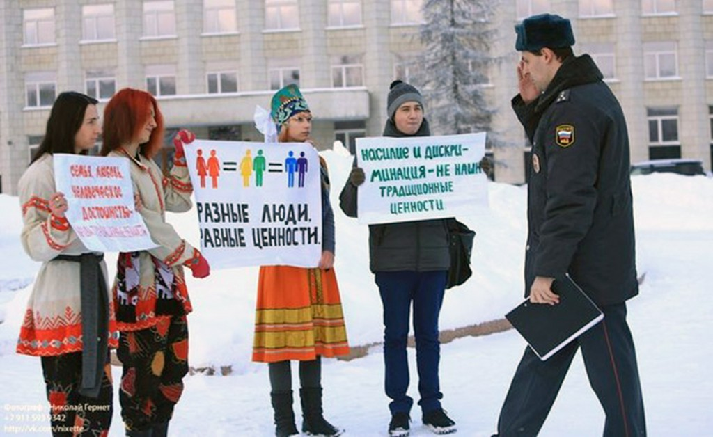 """Photo courtesy Perspective Gay rights activists protest in Archangelsk, Russia, in this undated photo provided by Perspective, a gay rights group in Archangelsk. The city in northern Russia is the sister city of Portland. Two members of Perspective will be in Portland this week as part of a trip funded by Human Rights First. The sign in the center says """"Different People, Equal Value."""" The sign on the right says, """"Violence and Discrimination are Not Traditional Values."""""""