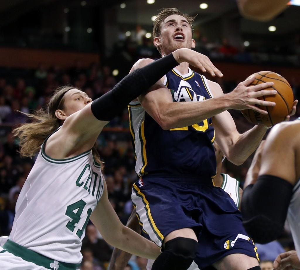 Utah Jazz forward Gordon Hayward (20) drives against Boston Celtics forwards Kelly Olynyk (41) and Jared Sullinger (7) during the first quarter of an NBA basketball game in Boston on Wednesday, Nov. 6, 2013. (AP Photo/Elise Amendola)