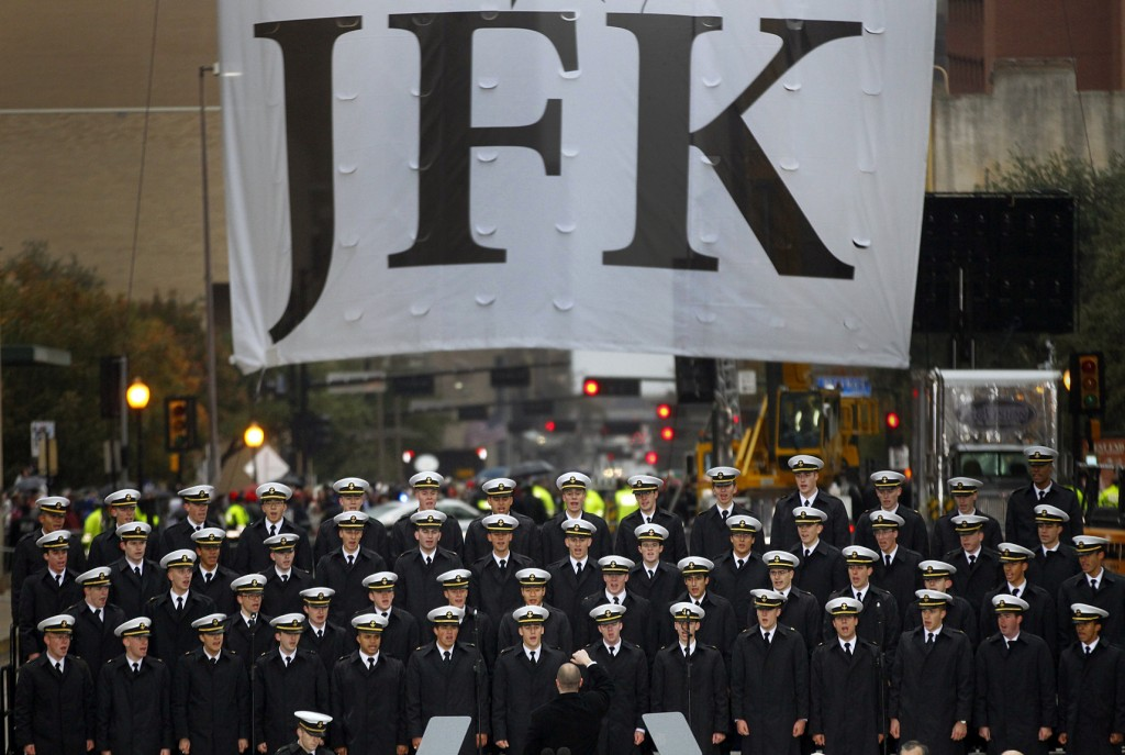 The U.S. Naval Academy Men's Glee Club sings the The Navy Hymn to close out the ceremony to mark the 50th anniversary of the assassination of John F. Kennedy on Friday in Dallas. President Kennedy's motorcade was passing through Dealey Plaza when shots rang out on Nov. 22, 1963.